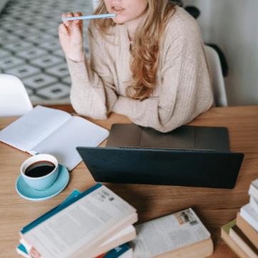 woman-writing-laptop-coffee